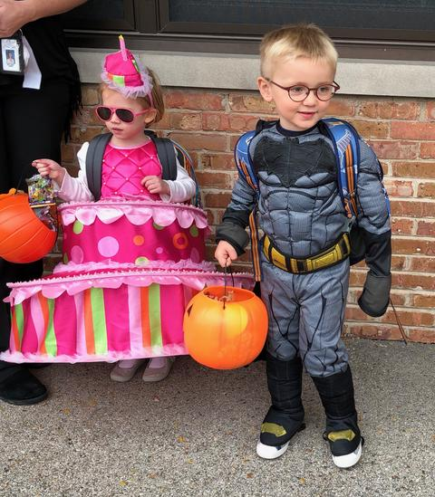 batman and cake costumes on students