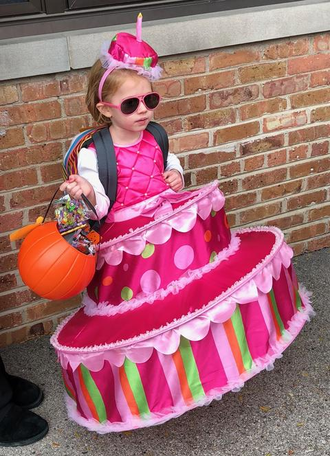 girl dressed as a cake