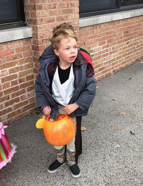 student with his pumpkin candy bowl