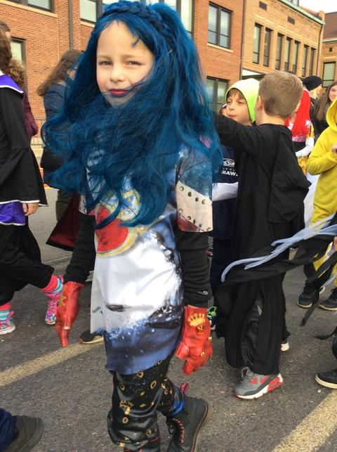 student dressed with blue wig