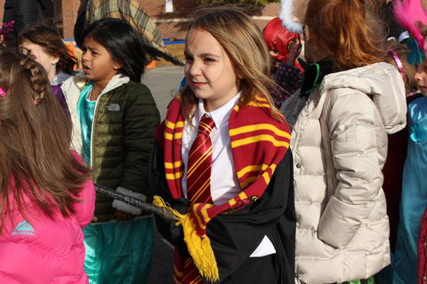 girl dressed as Harry Potter