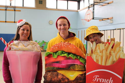staff dresssed as a burger, french fries and a milk shake