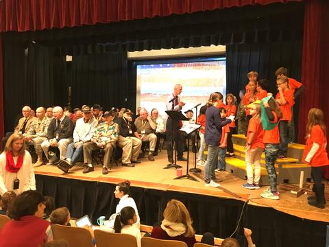 Veterans and students on stage during assembly