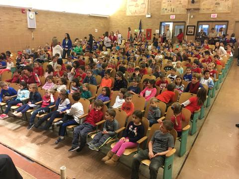 Picture of the students in the audience at assembly