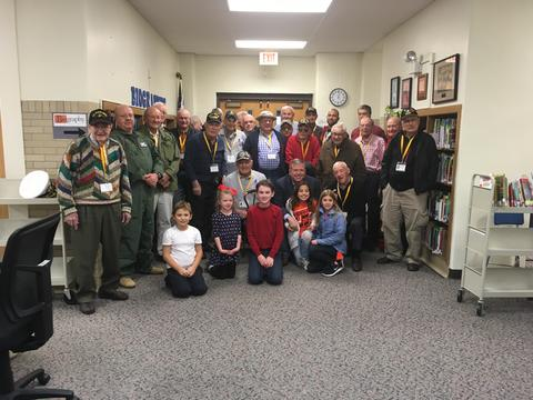 Full photo of all veterans and some students