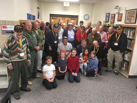 group shot of veterans in the library