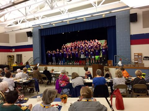 choral group performing for retiree breakfast