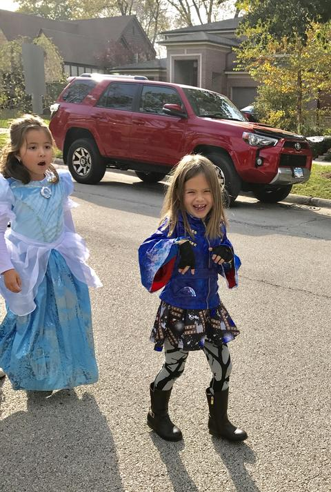 two young girls in halloween costumes