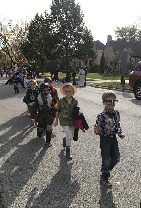 line of young boys in halloween costumes