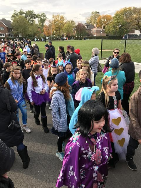 costumed students marching in parade for halloween