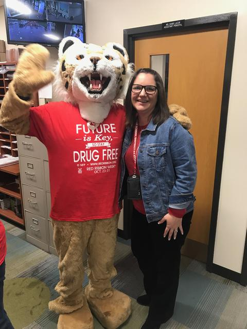 Washington principal with mascot for red ribbon week