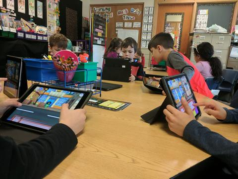 picture of two ipad screens during coding activity