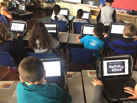Shot of full class coding from behind