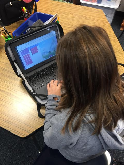 view of chromebook activity with student working