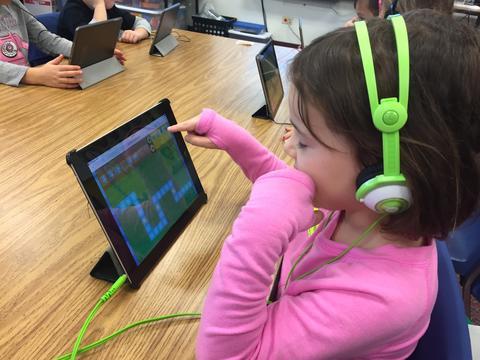 girl coding on her iPad