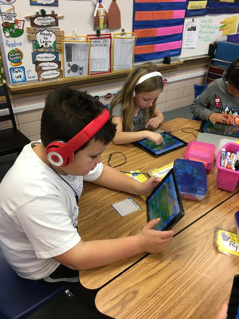 students using their ipads to code
