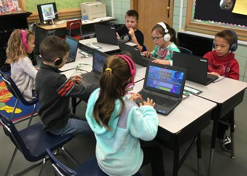 several students coding on chromebooks
