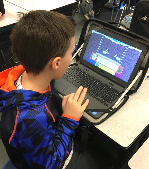 good view of coding screen on boy's chromebook