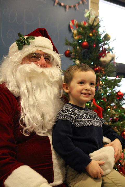 boy on santa's lap with big smile