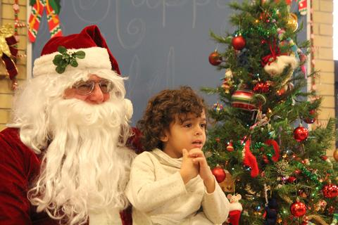 Student smiling with santa