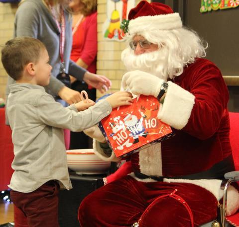 santa giving boy a gift bag
