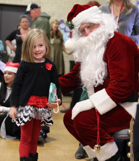 girl and santa smiling for picture