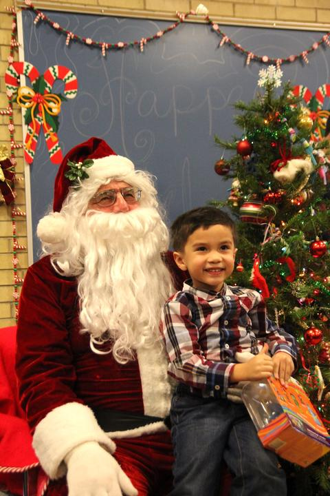 boy with big smile on santa's lap