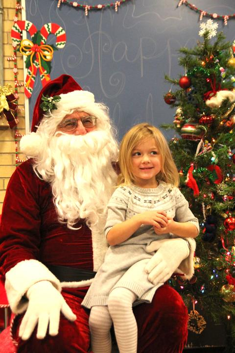 girl smiling with santa