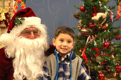 boy and santa smiling for picture