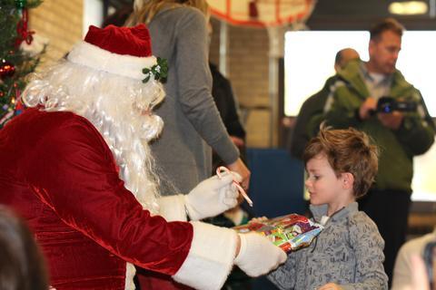 santa giving boy a candy cane