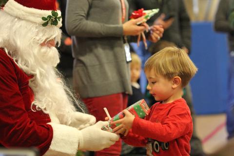 boy getting gift from santa
