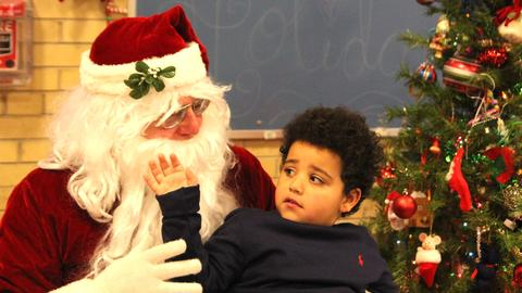 boy looking back at santa