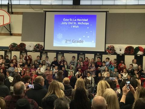 second graders performing at holiday sing