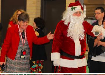 Ms. Halverson ushers Santa inside