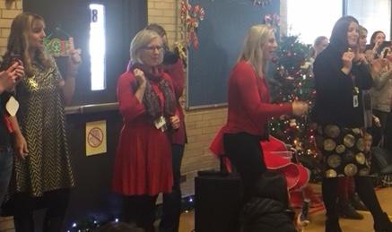 Teachers leading the singing