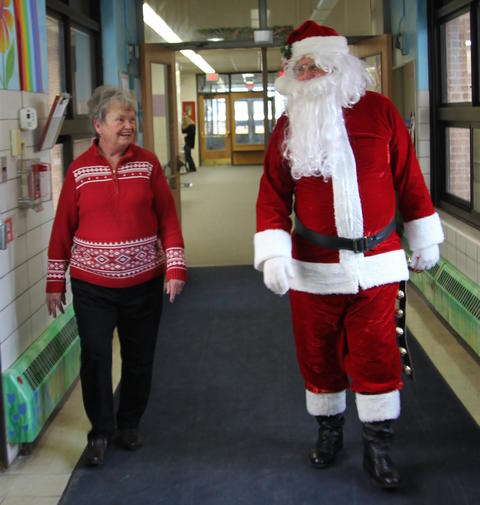 Santa and Mrs. Claus walk the halls