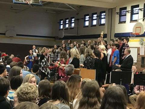 Choir performing in gym