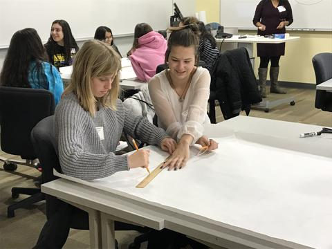 2 girls at a drafting table