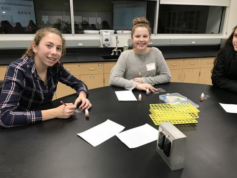 two girls working on samples