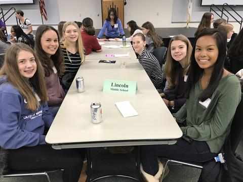 several girls at a lunch table