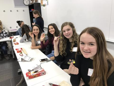 group of girls with robotikits