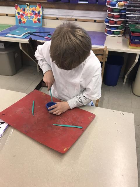 Young student working at Art table