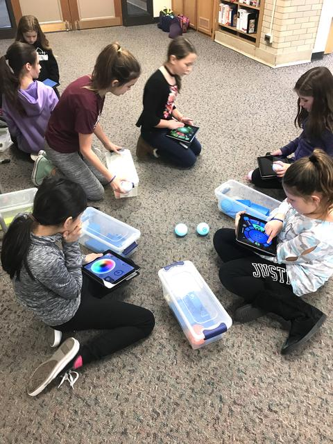 Girls working with iPads