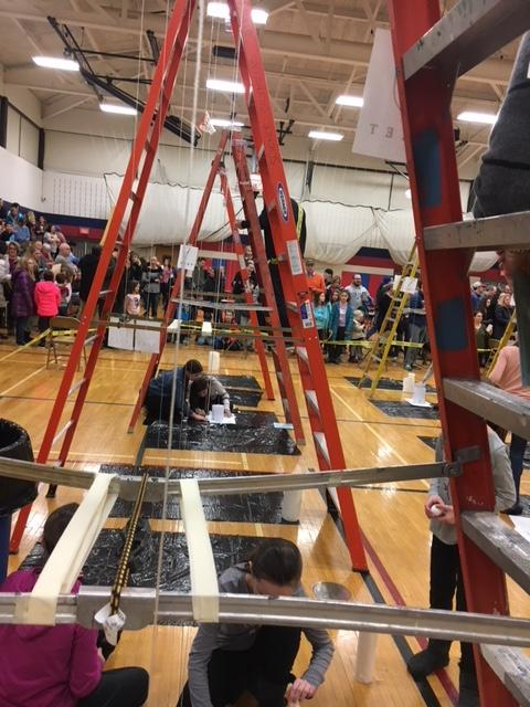 through the legs of a ladder for egg drop event