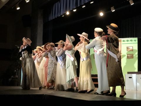 Suffragettes dancing on stage