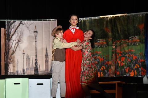 Banks children hugging Mary Poppins