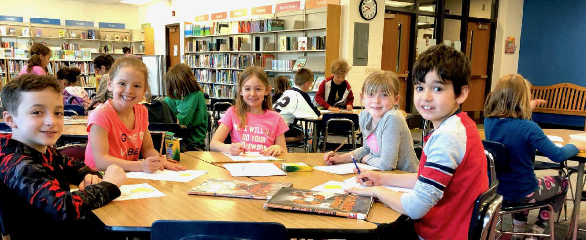 Students reading around library table