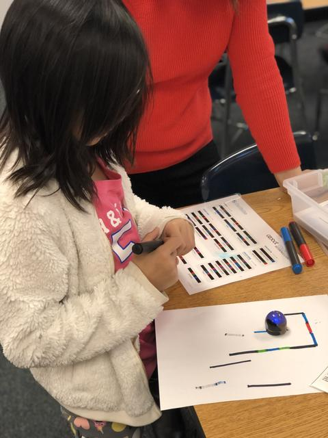 student working with ozobot