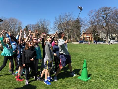 Students with PE teacher and selfie stick