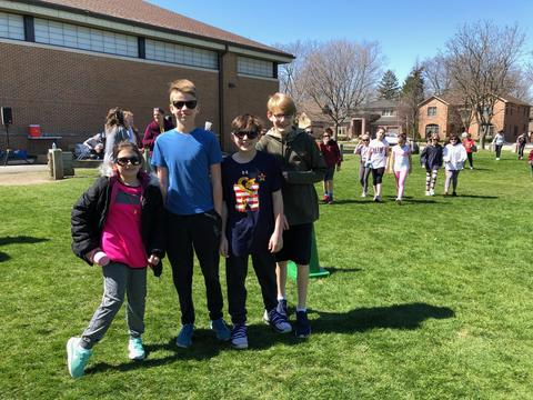 four students at walk - a - thon